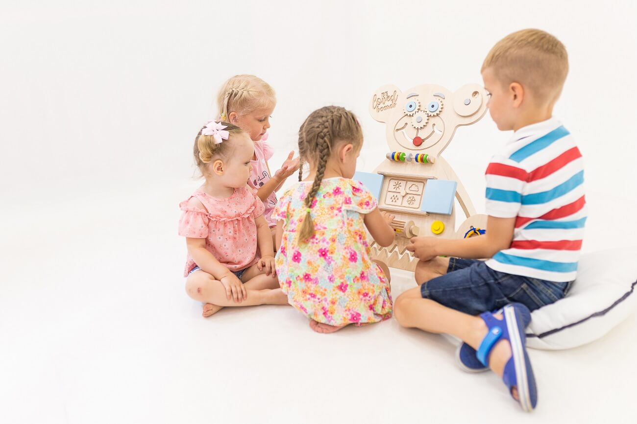 Kids playing with busy board
